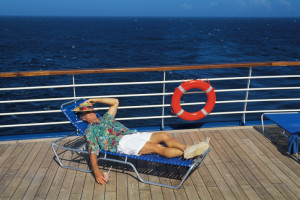 picture of man sleeping on deck of ocean cruise ship