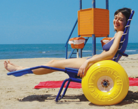 picture of special needs girl in a beach wheelchair