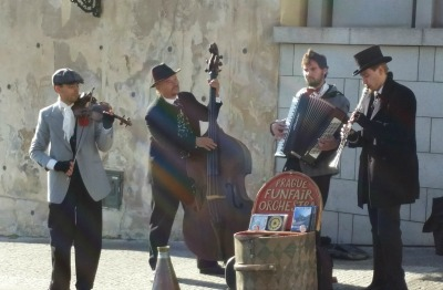 A picture of street musicians taken for a journal.