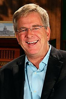 picture of travel expert Rick Steves who weighs in about travel insurance.
